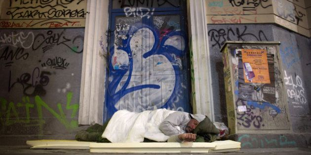ATHENS, GREECE - JANUARY 21: A homeless man sleeps in a doorway on the streets of Athens ahead of this...