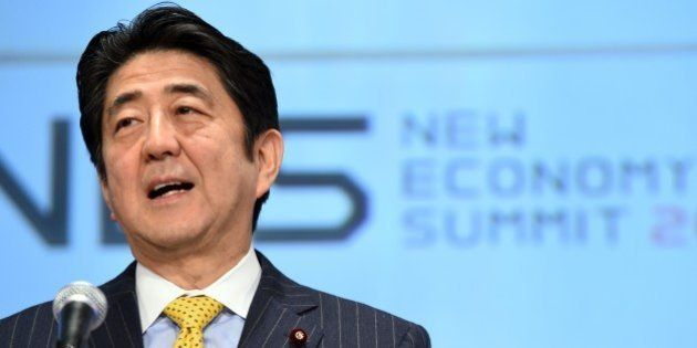 Japanese Prime Minister Shinzo Abe delivers a remarks during the opening of the New Economy Summit 2015...