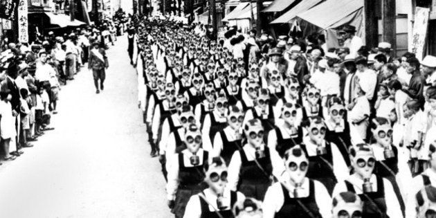 UNITED KINGDOM - OCTOBER 01: Japanese schoolgirls parade wearing gas masks. (Photo by Planet News Archive/SSPL/Getty