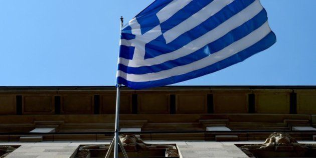 The Greek national flag is on display outside the Embassy of Greece to Germany on June 29, 2015 in Berlin....