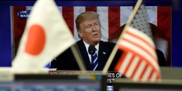 A TV monitor displays a broadcast of the congressional speech by US President Donald Trump at a foreign...