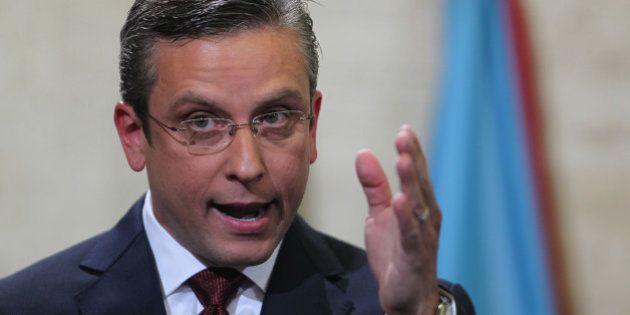 FILE- In this April 30, 2015, file photo, Puerto Rico Gov. Alejandro Garcia Padilla delivers his budget...
