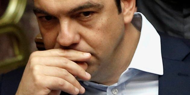Greece's Prime Minister Alexis Tsipras attends an emergency Parliament session for the government's...