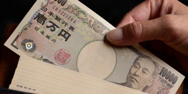 Japanese 10,000 yen banknotes are arranged for a photograph in Kawasaki, Kanagawa Prefecture, Japan,...