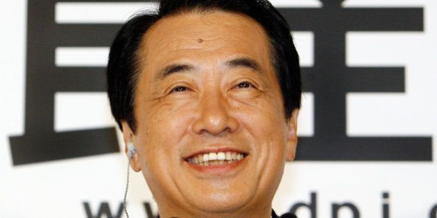Naoto Kan, acting leader of the main oppsition Democratic Party of Japan (DPJ), smiles as he answers...