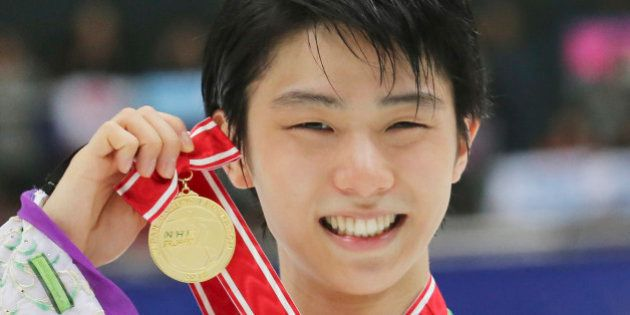 Japan's Yuzuru Hanyu poses with his gold medal during an award ceremony at the NHK Trophy figure skating...