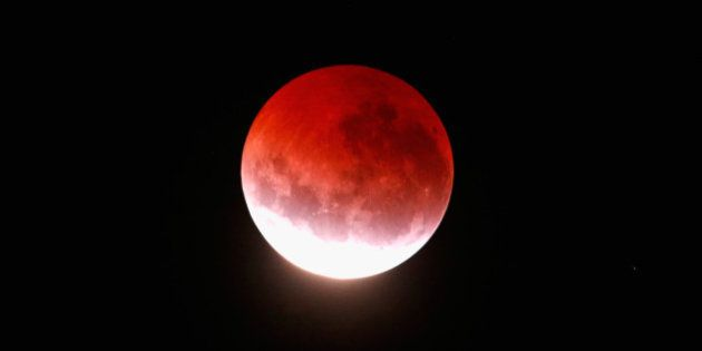AUCKLAND, NEW ZEALAND - APRIL 04: A blood red moon lights up the sky during a total lunar eclipse on...