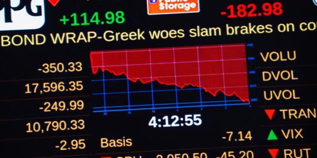 NEW YORK, NY - JUNE 29: A headline concerning Greece's debt crisis scrolls across a stock ticker at the...