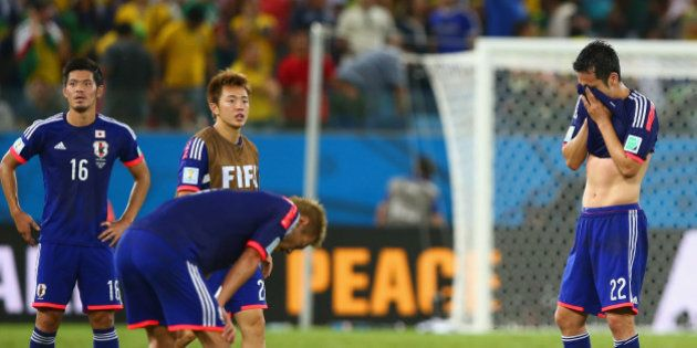 CUIABA, BRAZIL - JUNE 24: Maya Yoshida of Japan (R) reacts after the 2014 FIFA World Cup Brazil Group...
