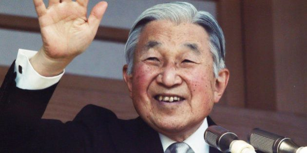 FILE - In this Jan. 2, 2016, file photo, Japan's Emperor Akihito waves to well-wishers from a bullet-proofed...