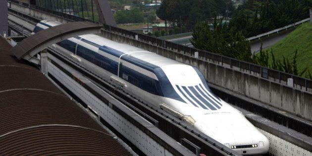 A magnetic-levitation (maglev) train passes at Central Japan Railway Co.'s Yamanashi Maglev test line...