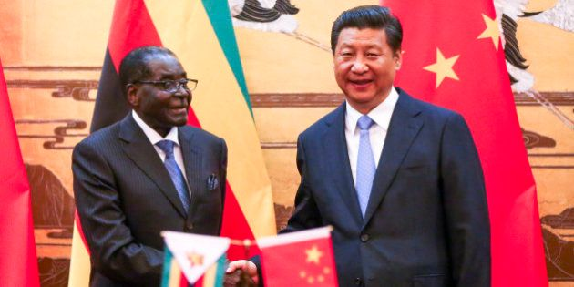 Zimbabwean President Robert Mugabe, left, looks on as his Chinese counterpart Xi Jinping applauds during...