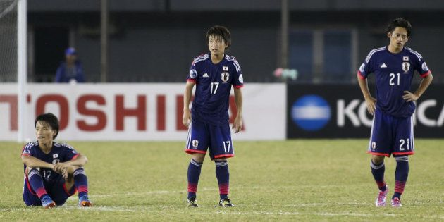 NAY PYI TAW, BURMA - OCTOBER 17: Japan players show their dejection after losing through a penalty shoot...