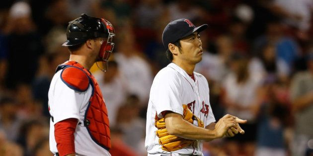 BOSTON, MA - JULY 1: A.J. Pierzynski #40 confers with Koji Uehara #19 of the Boston Red Sox in the ninth...