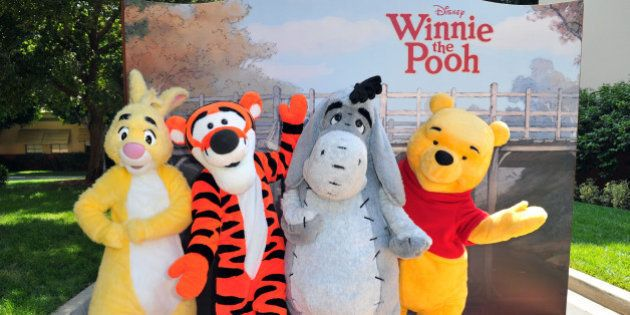 Rabbit, Tigger, Eeyore and Winnie the Pooh pose at Walt Disney Pictures presents the premiere of 'Winnie...