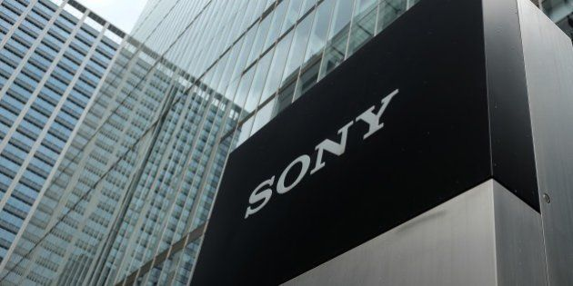 The logo of the Sony Corporation is displayed at an entrance to the company's headquarters in Tokyo on...