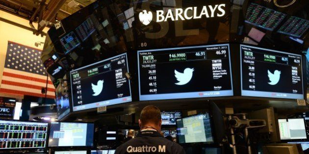 Screens display a Twitter logos and share price as it starts trading at the New York Stock Exchange (NYSE)...