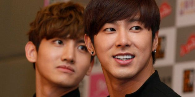 Members of the South Korean boy band TVXQ, Max Changmin, left, and U-know Yunho attend a news conference...