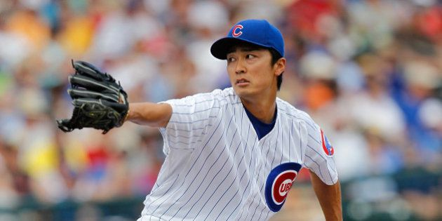 GOODYEAR, AZ - MARCH 25: Tsuyoshi Wada #67 of the Chicago Cubs pitches during a game against the Los...