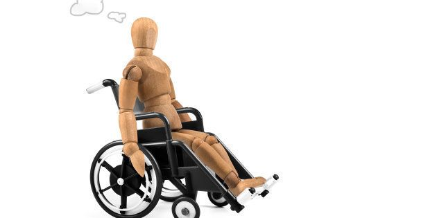 Disabled wooden mannequin in wheelchair thinking about cause, problems or