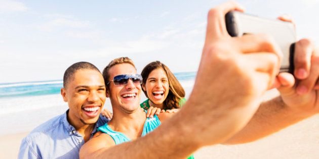 USA, Florida, Jupiter, Young people taking selfie on