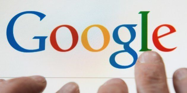 A person prepares to search the internet using the Google search engine, on May 14, 2014, in Lille. In...