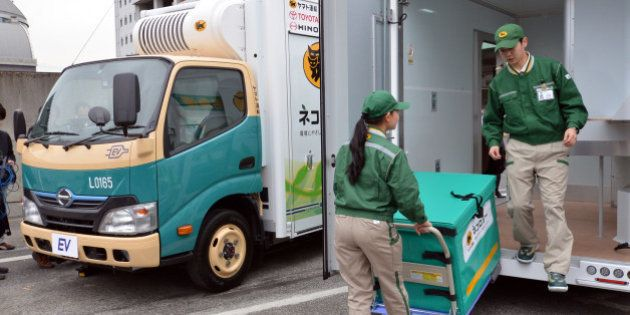Japan's auto giant Toyota Motor and its subsidiary Hino Motors display the new electric trucks, a one-ton...