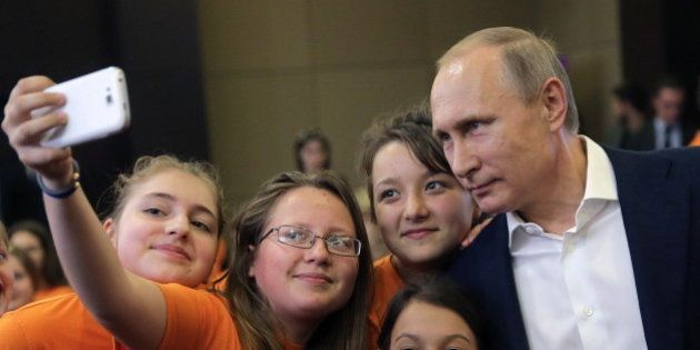 SOCHI, RUSSIA. MAY 10, 2016. Russia's President Vladimir Putin (R) poses for a photograph with kids at...