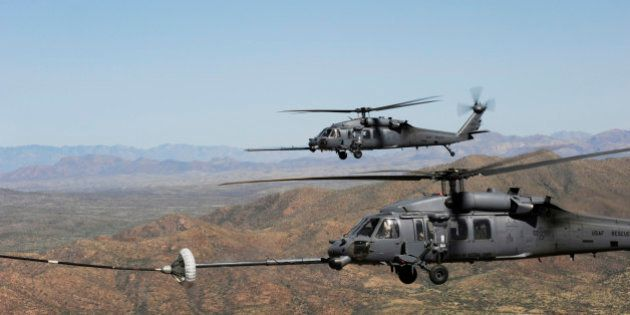 April 15, 2010 - Two HH-60 Pave Hawks refuel over the desert surrounding Davis-Monthan Air Force Base,...