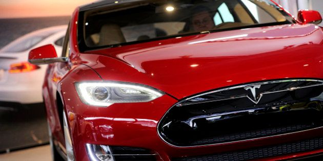 A Tesla Motors Inc. vehicle is displayed during the 2013 North American International Auto Show (NAIAS)...
