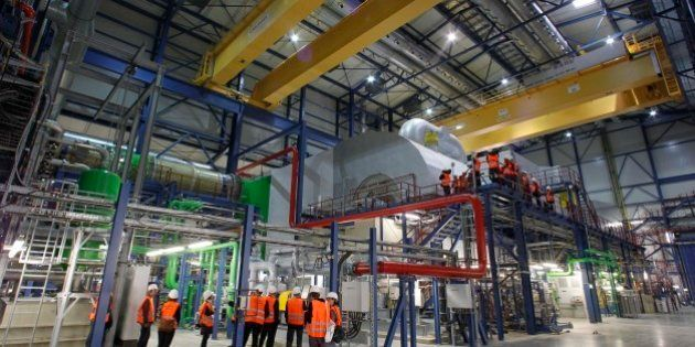 Visitors inspect the new gas-steam power plant in Irsching near Ingolstadt, southern Germany, on Thursday,...