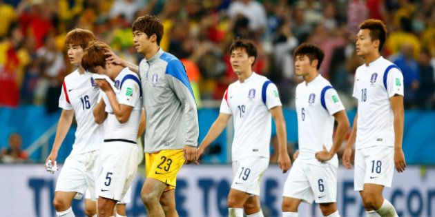 SAO PAULO, BRAZIL - JUNE 26: South Korea players look dejected after a 0-1 defeat to Belgium in the 2014...