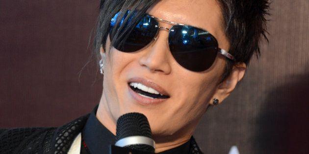 Japanese singer Gackt speaks on the red carpet as he arrives for the 6th Asian Film Awards in Hong Kong...