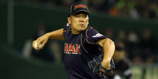 TOKYO, JAPAN - MARCH 08: Pitcher Masahiro Tanaka #17 of Japan pitches during the World Baseball Classic...