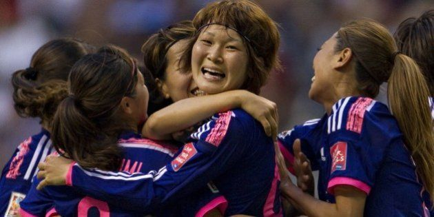 Japan's midfielder Mizuho Sakaguchi celebrates her goal against Netherlands with teammates during the...