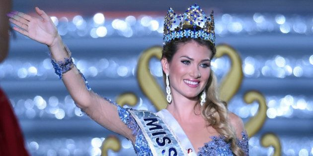 Mireia Lalaguna Rozo of Spain waves after winning the new title at the Miss World at the Grand Final...