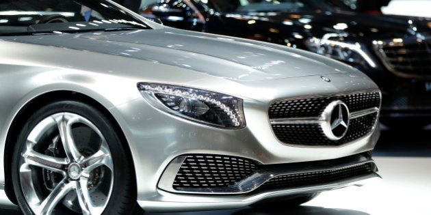 An attendee looks at Daimler AG's Mercedes-Benz Concept S-Class Coupe vehicle on display at the 43rd...
