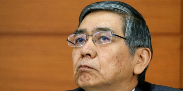 Haruhiko Kuroda, governor of the Bank of Japan (BOJ), listens during a news conference at the central...