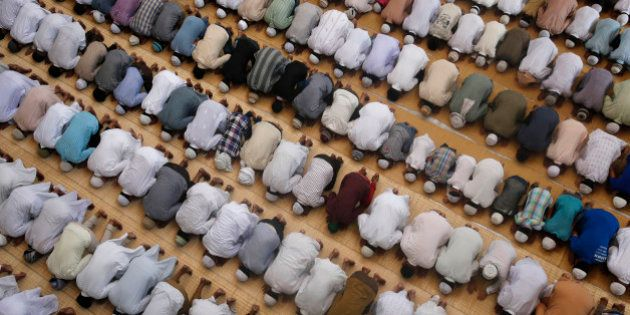 FILE - In this Friday, June 19, 2015, file photo, Indian Muslims offer prayers during the holy Islamic...