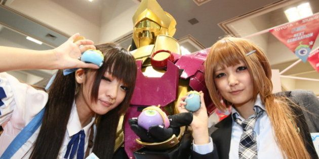 KYOTO, JAPAN - SEPTEMBER 08: Cosplayers pose for photo during Kyoto International Manga Anime Fair 2013...