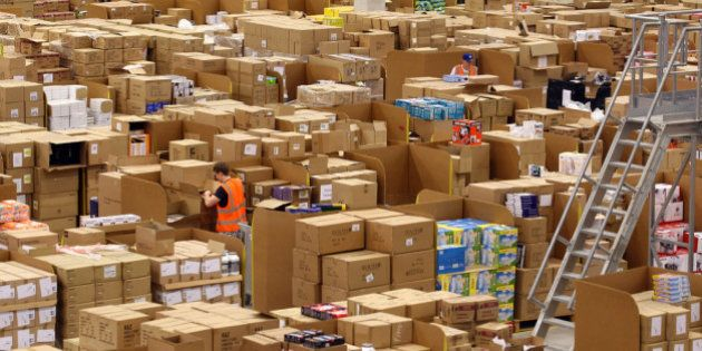 SWANSEA, WALES - NOVEMBER 24: Staff at the Amazon Swansea fulfilment centre process orders as they prepare...