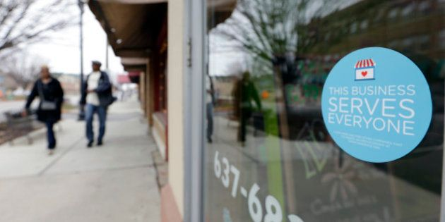 A window sticker on a downtown Indianapolis florist, Wednesday, March 25, 2015, shows it's objection...