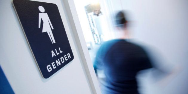 A bathroom sign welcomes both genders at the Cacao Cinnamon coffee shop in Durham, North Carolina May...