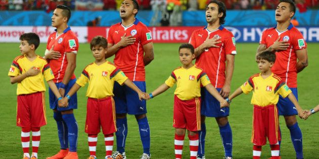 CUIABA, BRAZIL - JUNE 13: Chile line up and sing the National Anthem before the 2014 FIFA World Cup Brazil...
