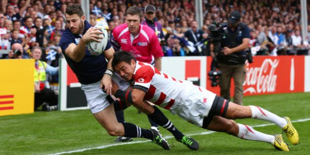 GLOUCESTER, ENGLAND - SEPTEMBER 23: Tommy Seymour of Scotland is tackled by Ayumu Goromaru of Japan as...