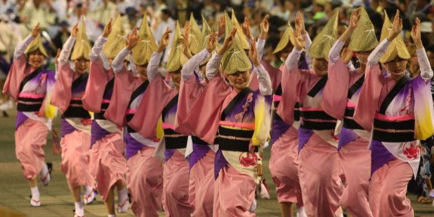 TOKUSHIMA, JAPAN - AUGUST 12: Japanese women dressed in traditional costume perform Awa-Odori dance during...