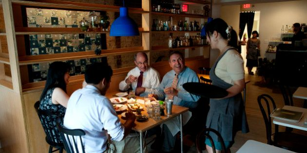 WASHINGTON, DC- AUGUST 8: Dinning guests Peter Kelley (center, white shirt), Bill Farrell (center blue...