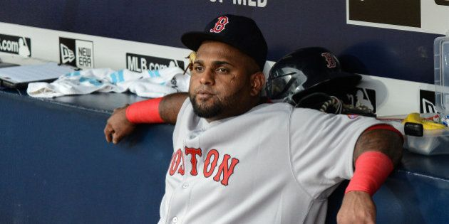 Boston Red Sox third baseman Pablo Sandoval (48) sits on the bench before the start of a baseball game...