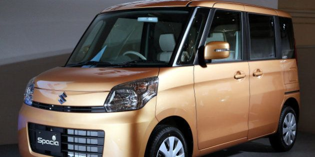 A Suzuki Motor Corp. Spacia minicar is displayed at its unveiling in Tokyo, Japan, on Tuesday, Feb. 26,...