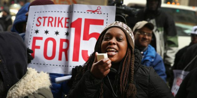 CHICAGO, IL - DECEMBER 05: Charde Nabors, a Sears employee, protests with fast-food and retail workers...